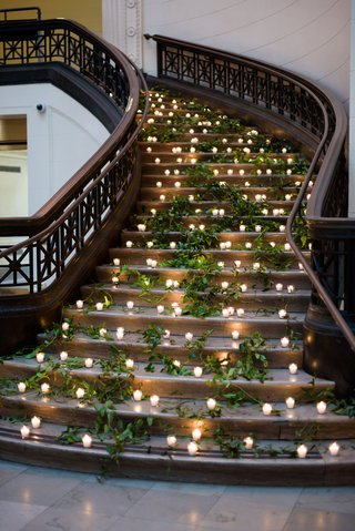 museum-wedding-reception-decor-stairss-decorated-with-fresh-greenery-and-candle-votives