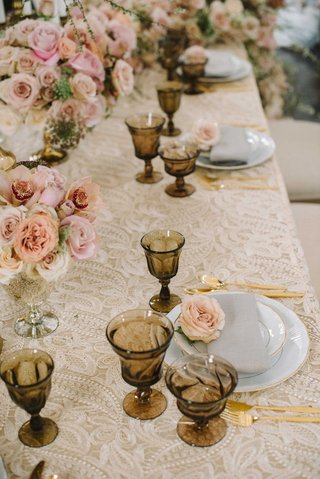 taupe-embroidered-table-linen-gold-wine-glasses-silverware-shades-of-pink-roses-low-centerpieces