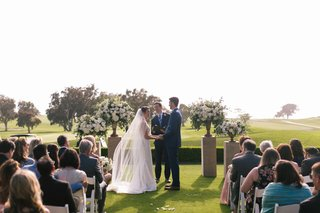 bride-and-groom-at-outdoor-ceremony-the-lodge-at-torrey-pines-friend-officiating-officiant-guests