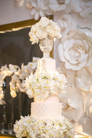 tall-white-wedding-cake-with-orchids-chalice-on-top-tier