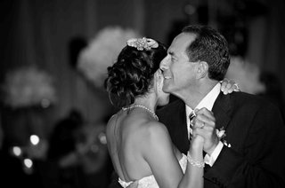 black-and-white-photo-of-dad-crying-while-dancing-with-bride