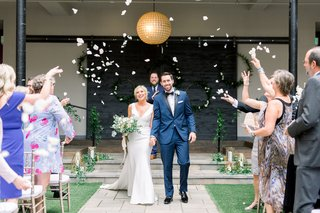 newlyds-showered-with-rose-petals-during-their-recessional