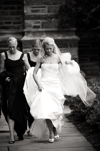 black-and-white-bridesmaids-help-carry-the-brides-train