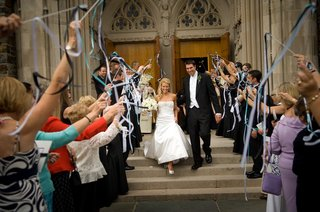 guests-wave-ribbons-as-newlyweds-walk-past