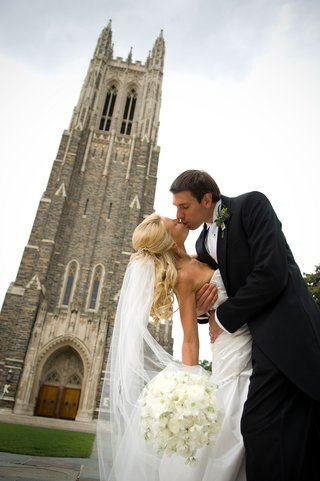 couple-kisses-outside-duke-university-chapel
