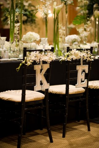 letters-k-and-e-hung-on-back-of-chairs