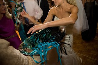 bride-passes-out-blue-and-green-masquerade-masks