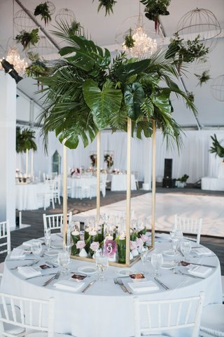 modern-tropical-wedding-reception-gold-stand-greenery-centerpiece-with-palm-fronds-elephant-ears