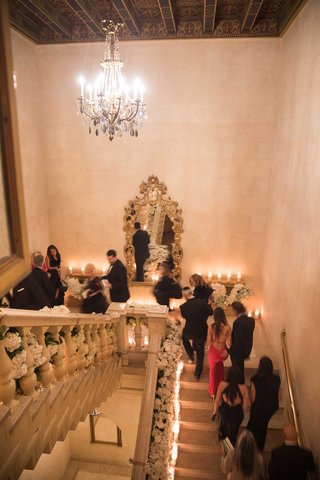 wedding-reception-grand-staircase-candles-flowers-guests-walking-up-staircase