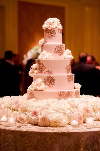 wedding-cake-with-fresh-flowers-and-rose-gold-stencil-design-peony-candles