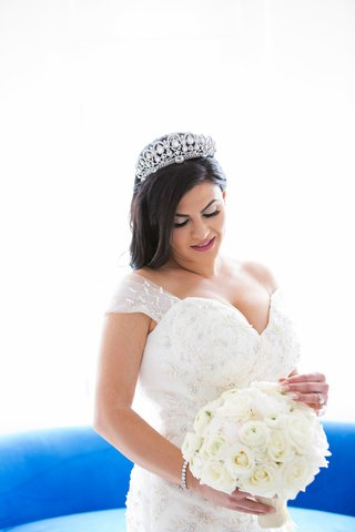 bride-holding-bouquet-of-rose-ranunculus-white-flowers-with-matthew-christopher-gown-and-tiara