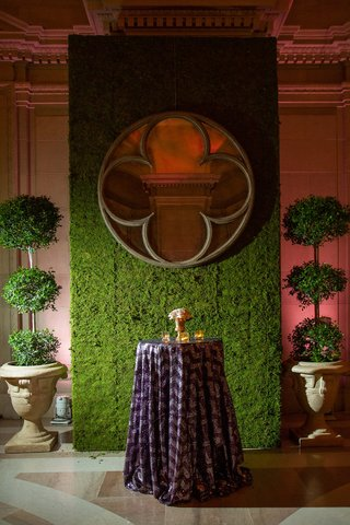 manicured-topiaries-and-green-grass-wall-with-mirror