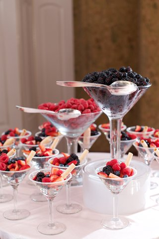 wedding-desserts-of-strawberry-blackberry-blueberry-cookie-straws-in-martini-glasses