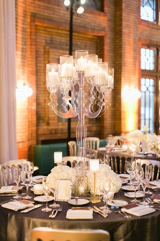 round-reception-table-grey-linen-with-crystal-table-number-white-flowers-candles-tall-lucite-candle