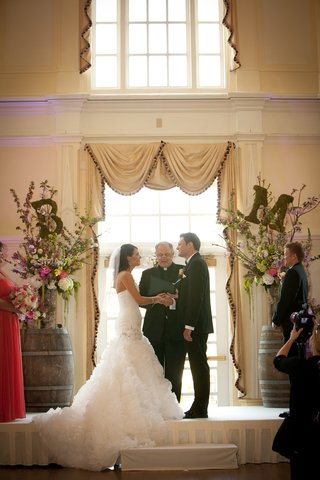 bride-and-groom-at-wine-barrel-altar