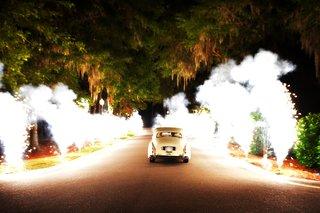 pyrotechnics-line-a-driveway-as-newlyweds-drive-off