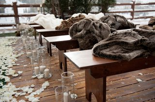 outdoor-winter-wedding-ceremony-with-fur-blankets-on-wood-benches
