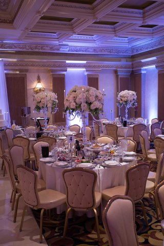 lots-of-food-on-wedding-table-armenian-reception-white-rose-blush-flower-centerpiece-on-candelabra