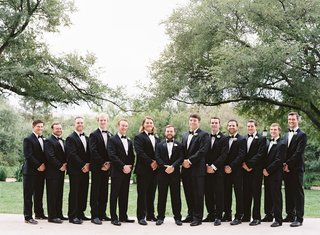 outdoor wedding portrait groom and groomsmen in tuxedos formal wedding party texas