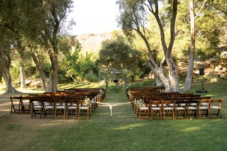 outdoor-wedding-ceremony-at-hummingbird-nest-ranch-olive-trees