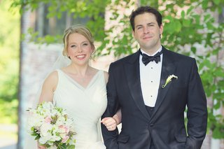smiling-woman-in-wedding-dress-and-man-in-tux