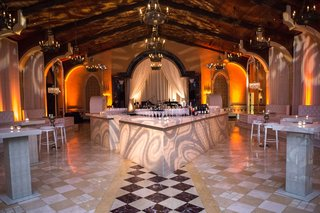 wedding-after-party-with-light-projections-nightclub-vibe-diamond-tile-floor-tufted-furniture-after