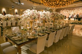 wedding-reception-long-table-with-tall-centerpieces-dance-floor-live-band-stage-with-glitter