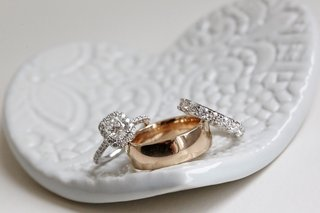 bridal-jewelry-wedding-ring-and-engagement-ring-with-mens-band-in-heart-shaped-white-dish-holder