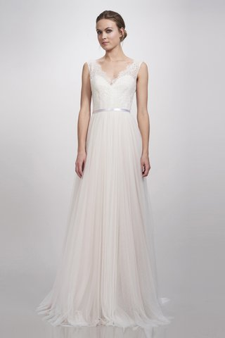 an-a-line-dress-with-a-slight-v-neckline-illusion-details-in-the-sleeves-a-thin-belt-and-a-tulle