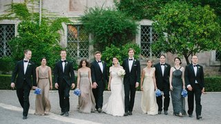 groomsmen-and-brides-in-mismatched-dresses-carrying-blue-bouquets