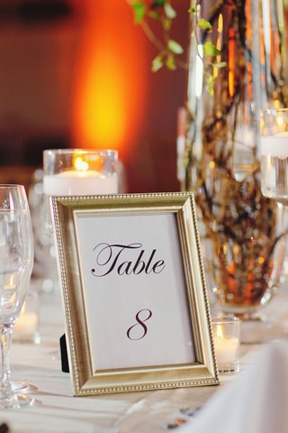 antique-style-gilt-frame-with-table-number-on-guest-table
