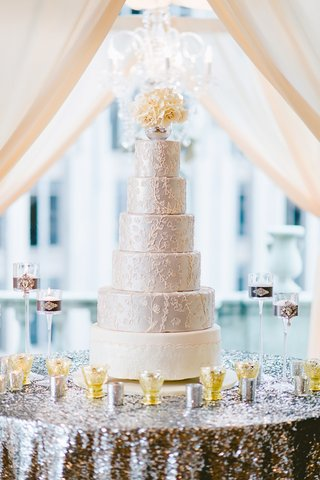 six-layer-wedding-cake-with-white-bottom-and-silver-top-tiers