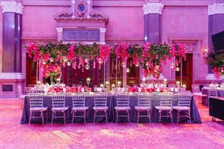 indoor-wedding-reception-table-with-trellis-inspired-orchid-and-greenery-flower-arrangement