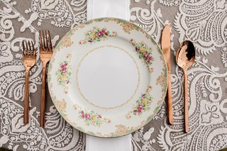 rose-gold-forks-knife-spoon-with-pink-yellow-green-flower-print-china-plate-white-grey-linen-wedding