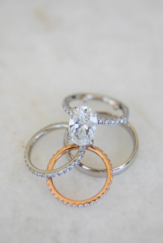 wedding-rings-grooms-polished-platinum-band-bride-oval-cut-pave-engagement-ring-and-rose-gold-band