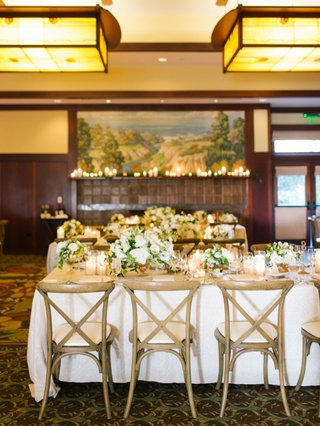 the-lodge-at-torrey-pines-wedding-reception-wood-vineyard-chairs-white-linen-greenery-white-flowers