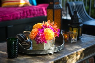 orange-chrysanthemums-hot-pink-orchids-in-gold-rectangular-vase-at-engagement-party