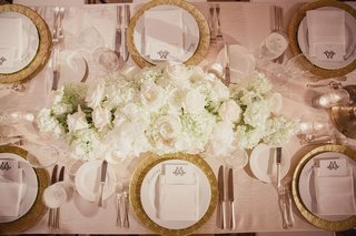 gold-charger-plate-and-low-centerpiece-arrangement-of-hydrangea-roses-and-peonies