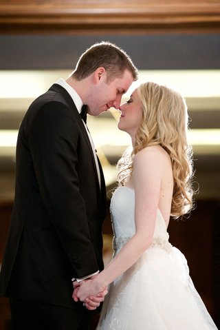 bride-in-vera-wang-strapless-wedding-dress-long-blonde-hair-eskimo-kiss-with-groom-in-tuxedo-chicago
