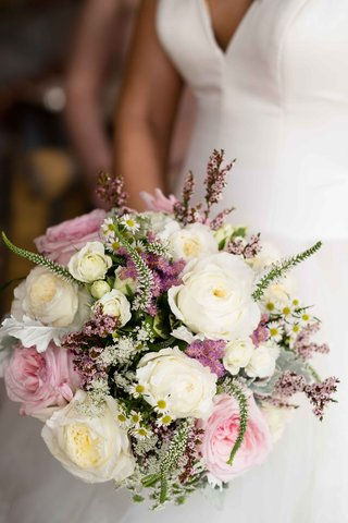 a-soft-bouquet-made-up-of-white-pink-light-purple-flowers-and-small-sprigs-of-foliage