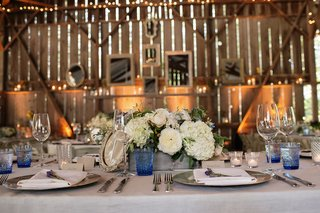 barn-wedding-venue-with-rustic-and-vintage-table-decorations