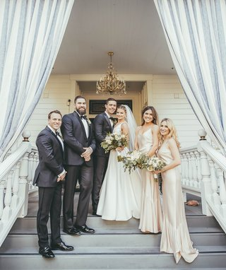 small-bridal-party-with-two-bridesmaids-and-two-groomsmen-bride-in-stella-york-wedding-dress