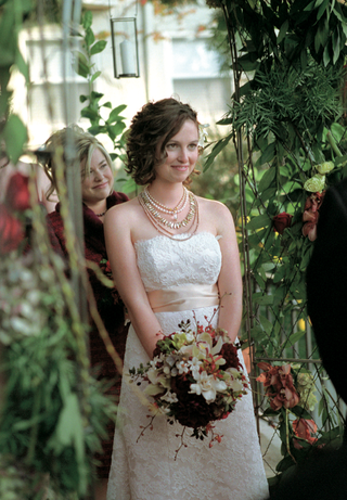 bride-holding-bouquet-wearing-multiple-necklaces