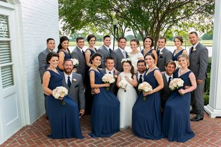 bride-groom-in-grey-suit-groomsmen-in-grey-suits-navy-ties-bridesmaids-in-long-navy-dresses