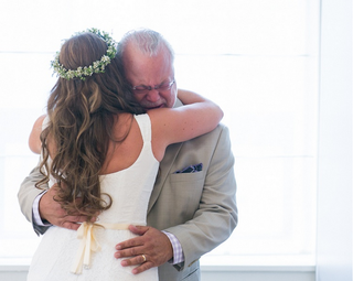 father-of-bride-cries-as-he-hugs-his-boho-bride-daughter