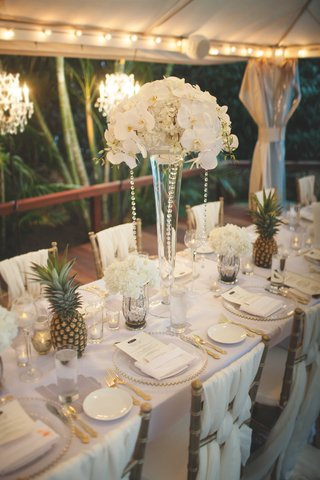 destination-wedding-intimate-small-reception-long-table-draped-linens-on-chairs-white-orchid-flowers