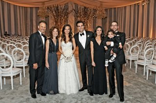 bride-and-groom-with-mother-of-bride-in-grey-dress-and-family