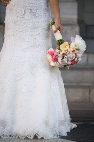 lace-embroidered-wedding-dress-and-vibrant-flowers