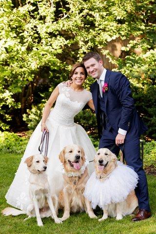 bride-in-a-line-wedding-dress-groom-in-navy-suit-golden-retriever-dog-flower-girls-ring-bearers