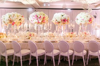 blush-and-ivory-flower-arrangements-with-glass-candelabra-with-candles